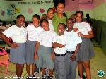 PIO Melody Rames poses with school children
